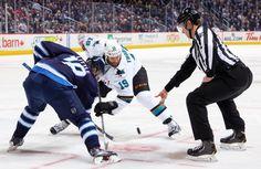 San Jose Sharks forward Joe Thornton takes a face-off against Byran Little of the Winnipeg Jets (Nov. 10, 2013).