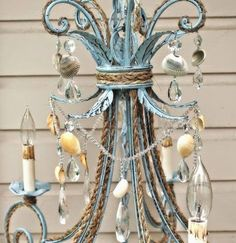 Have fun with your chandelier and decorate it...http://www.completely-coastal.com/2014/06/DIY-beach-chandelier-ideas.html