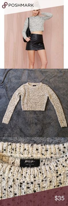 Nasty gal cropped sweater. Never worn  has a tag Salt and pepper grey cropped knit sweater. Fabric is very thick and also has a bit of sparkle (shown in the last picture). Comes down to just under the ribs. Definitely a size small Nasty Gal Sweaters Crew & Scoop Necks