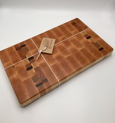 This Maple end grain cutting board has accent of oak/hickory/walnut/cherry. The board has been sanded and finished with mineral oil and beeswax. Hand groves and rubber feet have been add to the bottom of the board. End grain boards make a premier cutting service and Maple is the number one wood