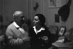 """Pablo Picasso and Jacqueline, stand side by side, holding glasses of champagne. Ten days after wedding. """"Goodbye Picasso"""" p.242"""