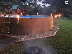 Reed privacy fence added around our above ground pool accented with tiki torches and landscaping!