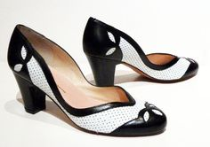 """A curvaceous """"spectator"""" pump with a deep V-cut vamp and perforated leather upper. - Leather uppers with leather soles - Whole and half sizes, 5 ½-11 (Runs big; order a half size smaller) - Medium wid"""