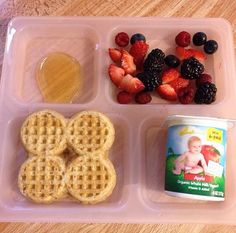 Toddler breakfast ideas. Waffles with mixed berries and yogurt.