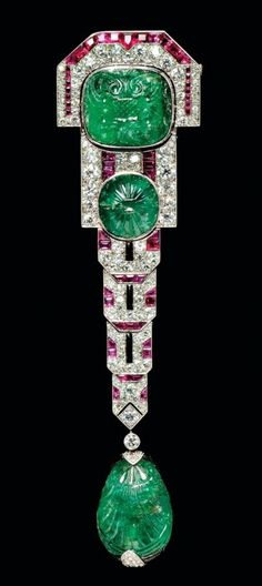 Art Deco carved emerald, ruby and diamond pendant brooch, Chaumet, Paris. 1920s