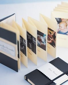 Baby's first timeline. A small journal with accordion-fold pages holds a photographic time line of baby's firsts. Another book contains pockets that can hold handwritten notes for your little one.