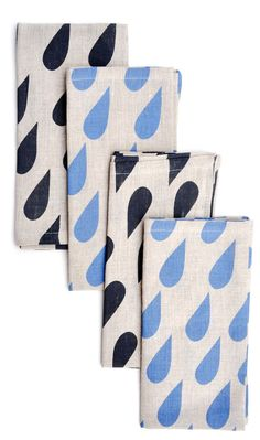 "Raindrops Linen Napkin Set      Pretty precipitation: blue and black raindrops decorate this set of napkins in natural linen.      -  Set of 4 napkins     -  Linen    -  19"" x 20""    -  Machine wash"
