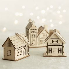 Decorate the tree with our miniature village of laser-cut structures in a natural wood finish with architectural detailing.  Each features a rustic jute hanging cord. Carb-compliant plywoodMade in China.