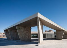 Folded concrete canopy shelters Spanish bus station by Ismo Arquitectura.