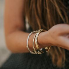 Sleek and elegant on their own or when stacked, our beautiful bangles draw inspiration from natural forms and are handcrafted in recycled sterling silver and 18ct gold vermeil and all our bangles can be personalised. #silverbracelet #surferstyle #summerstyling #goldbracelet #classicgold #silverbangle Surfer Style, Personalized Bracelets, Classic Gold, Natural Forms, Dainty Jewelry, Silver Bangles, Handcrafted Jewelry, Jewellery, Sterling Silver