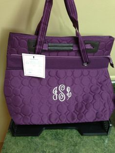 White personalization on plum quilted dots.