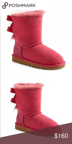 "UGG Bailey Bow Girls Boots in Cerise UGG Bailey Bow Boots.  NWT.  I'm a size 6.5 and these fit perfect.  Super-cozy suede is fashioned into a favorite short boot trimmed with double bows at the back. The soft, cozy lining is made from genuine shearling and plush UGGpure, a textile made entirely from wool but crafted to feel and wear like genuine shearling.   1"" heel (size 1). UGG Shoes Rain & Snow Boots"