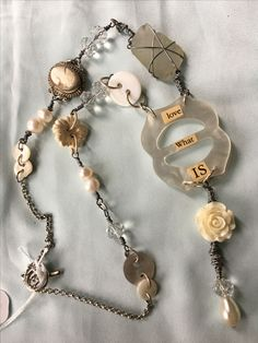 Found Object Jewelry created by Bernadette Malmsten of Two Roads Studio.  Incorporates vintage and new materials such as pocket watch, rosary beads, gold, silver, coins, keys, spoons. www.tworoadsstudio.com