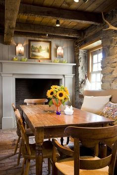Cozy stone cottage with brick floors and fireplace in the kitchen