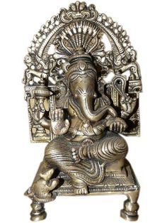 Lord Ganesha Brass Statue Seated Over Chowcki Diwali Gift Ganesh Sculptures 8 Inches by Mogul Interior, http://www.amazon.com/dp/B00A33E4LK/ref=cm_sw_r_pi_dp_J6pQqb14PXYVH
