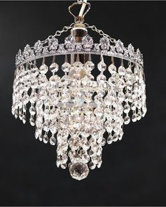 A Beautiful Single Light Crystal Chandelier With An Lovely Waterfall Design Sparkling Chains Of Octagonal Lead Crystals Are Suspended From Concentric Rings