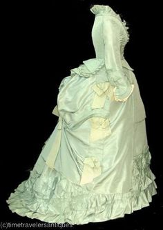 "Original caption says ""Seafoam green bustle 1880s""; But , based on the high waist and fullness of the skirts, it appears to me to be a first generation bustle (circa late 1860s, early 1870s). >>"