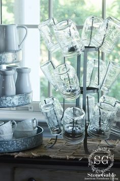 Love the mason jars stored on a bottle rack for drinks and easy access! StoneGable: THE SUMMER FARMHOUSE KITCHEN