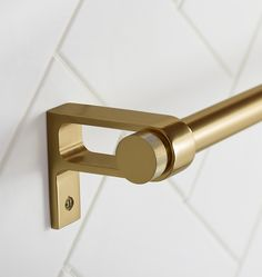 "Inspired by the simple lines and functionality of Northwest Modern architect John Yeon's cabinet and door hardware, our West Slope hardware collection was designed in-house and offers sturdy dimensions, unadorned geometry, and flat circle finials.  * Brass * Also available in 24"" width * Mounting hardware included * Imported"
