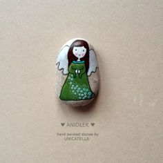Little green angel painted rock