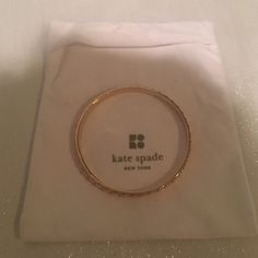 Kate Spade Gold Plated Studded Bangle Cute gold plated Kate Spade bangle with stud details.  Never worn --- Comes with white velvet pouch. kate spade Jewelry Bracelets