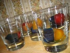 Add a drop of food coloring to each 'cube' of water and freeze. Put the different color combinations in the glasses and make predictions on the color outcome.