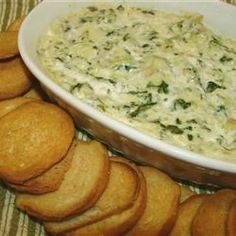 """""""This spinach dip is a huge hit at parties!  It has become one of our favorite appetizers to serve guests when we entertain.  Prepare ahead, but serve warm from the oven with fresh bread, crackers, chips, pita, etc."""""""