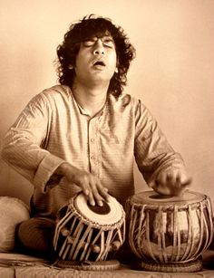 Ustad Zakir Hussain lost in the rhythms of his mesmerizing TABLA beats...!