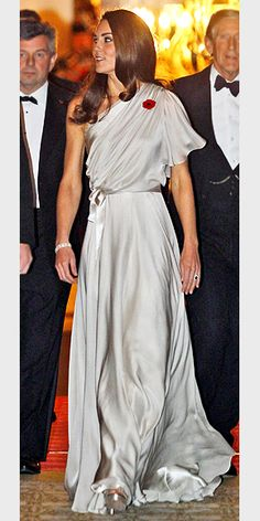 Perhaps Kate's trip to Tinseltown inspired her taste for this draped, belted Jenny Packham gown with an Old Hollywood vibe, worn to a London charity benefit in November. (Angelina Jolie wore the same style in orange earlier that year!)