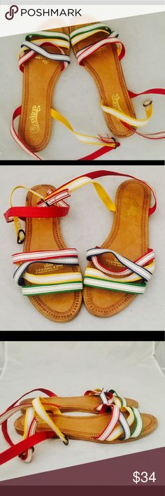 """Vintage 80s Rainbow Sandals Ankle Straps 8.5 Super cute 80's rainbow sandals with a cross over ankle strap.  Material: man made Maker: Coasters Origin: Taiwan Era: 80's Size:marked 9 fit like an 8.5 I'm an 8M and they fit me 1/2 size big  European size 39 40 depending on your region  Measurements: Insole- 10""""  Width 3.5"""" (at the upper bridge)  Heel- 1/4""""  Condition: the soles show slight wear but are still in fine condition. Vintage Shoes Sandals"""