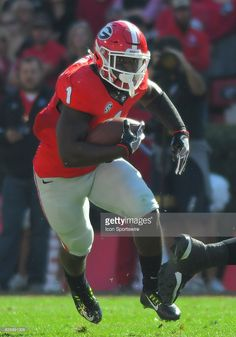Sony Michel Georgia Bulldogs running back carrying the ball during the game between the Georgia Tech Yellow Jackets and the Georgia Bulldogs on November at Sanford Stadium in Athens, GA. Ncaa College Football, American Football, Motocross Videos, Best Running Backs, Sanford Stadium, Georgia Bulldogs Football, Football Equipment, Georgia Girls, Yellow Jackets