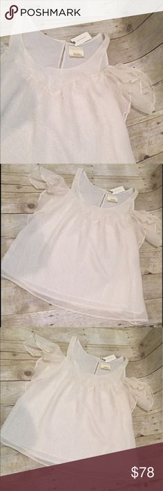 ANTHRO size 12 NWT cream cold shoulder top ANTHROPOLOGIE cold shoulder cream NWT size 12 top 20 inch bust approx and length approx 24 inches. Top is lined.  100 poly. Anthropologie Tops Blouses