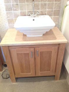 Solid oak vanity unit with crema marfil marble top. Aspenn Furniture solely make vanity units from solid natural woods which are designed by you to compliment your bathroom. We can make to any size + colour so it will fit perfectly in your bathroom. Visit www.aspennfurniture.co.uk to design your own perfect vanity unit and we'll email you back a quote within a day. If you'd like to discuss anything call 01937 843386 or email ianaspenn@btinternet.com