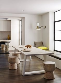 I like the bold simplicity of the table and stools