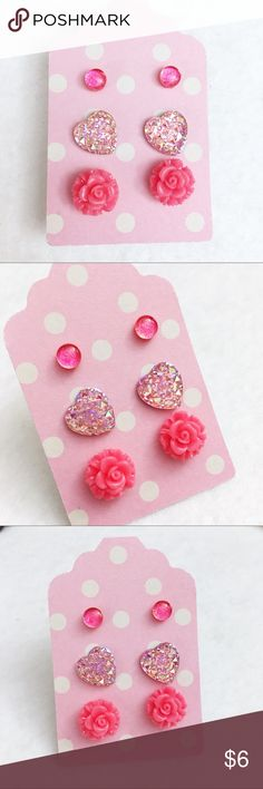Beautiful Pink 3 pack studs by Jules Jewelry Box Beautiful pink themed stud earrings by Jules Jewelry Box.  Small 4mm coral glass dome studs.  Gorgeous, iridescent pink 12mm hearts 💕  Coral pink 10mm flower studs 🌸 Jules Jewelry Box Jewelry Earrings