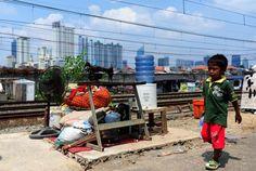 En un barrio de #Yakarta #Indonesia #fotografia de Zulkarnain (@Xinhua9 via twitter) #Infancia #Children #Asia