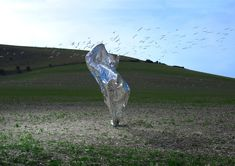 """Neal Grundy's """"Transient Sculptures"""" Appear for a Second Then are Gone Photographer Neal Grundy captures a fleeting existence in his series titled """"Transient Sculptures."""" Comprising flowing fabrics among outdoor lands... http://drwong.live/weird/neal-grundy/"""