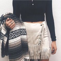 Fringe suede skirt. Brand new with tags. Perfect condition. Crying as i'm making this listing bc i just purchased from another seller and its too big for my baby sized body. Honestly a inch smaller and id keep. Offers welcome its beyond beautiful!  would trade only for something super good! Nasty Gal Skirts Mini