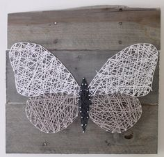 Butterfly on Reclaimed Wood Canvas String Art by ElevenOwlsStudio