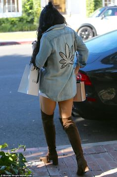 Rearly naughty: The marijuana leaf on the back of her shirt was even bigger than the one on the front