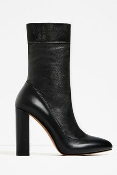 This Zara Leather Ankle Boot gives the look of black pumps with black socks, and we're really loving it.