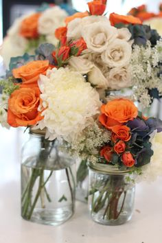 Love the color combo! it's so hard to find things that go with orange and DON'T look tacky! great for a wedding center pieces