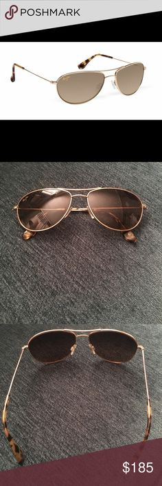 Maui Jim Baby Beach Polarized Sunglasses Like new!!!! Gold Baby Beach Sunglasses. Polarized. Super delicate scratches on left lens (as pictured). Otherwise in fantastic condition. The case is also missing ... but I will package extremely well when sold. Maui Jim Accessories Sunglasses
