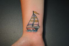 "Small sailboat tattoo with ""I am not afraid of storms for I am learning how to sail my ship"" quote."