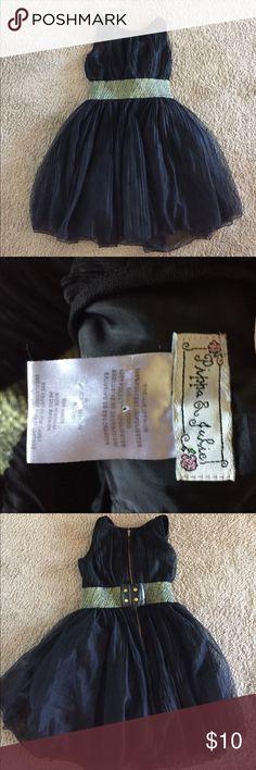 Girls black dress size 12 Girls black dress size 12. No rips. Great shape. Very pretty Pippa & Julie Dresses