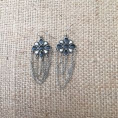 Earring #3 Black and silver colored flower earrings with chains. Bundle with other items in my closet for a discount!! Jewelry Earrings