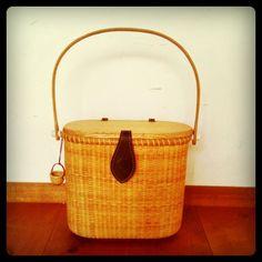 Nantucket basket hand bag with oak handle and lid.