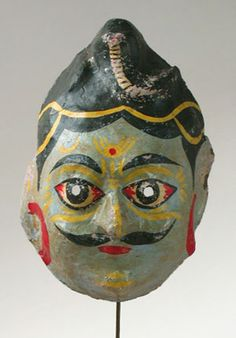 Hindu God mask    India    10.5 inches, painted papier mache    A common type of Indian papier mache mask. These are cheaply made by hand and sold to the common folk for festivals and other celebrations. What is nice about this one is that it is old and used, and a good example of traditional folk art.