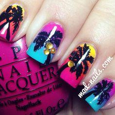 Multi coloured sunset palm tree nail art design