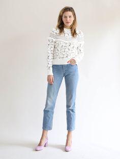 3D lace sweatshirt with v fringe detail. 100% cotton.